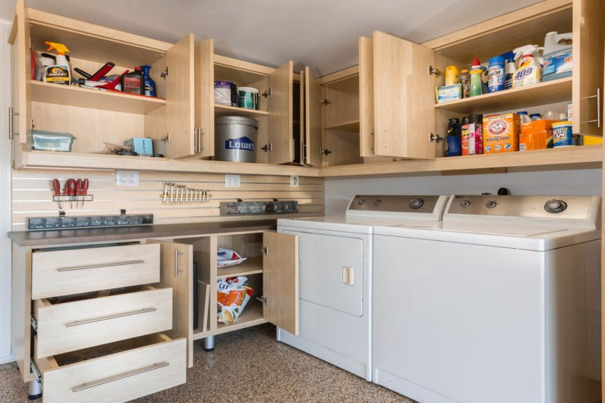 This laundry room boasts walnut cabinetry and counter. The flooring looks stylish.