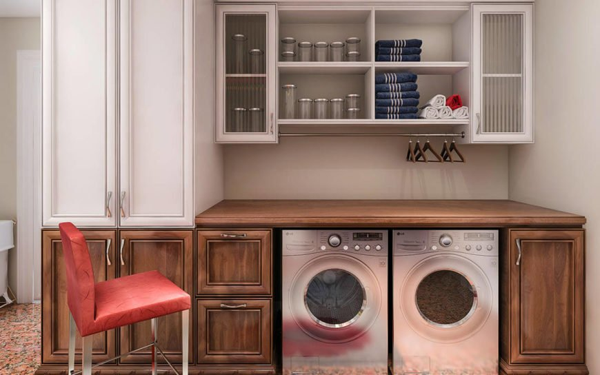 A single wall laundry area featuring a brown counter with a stainless steel washer and dryer combo.