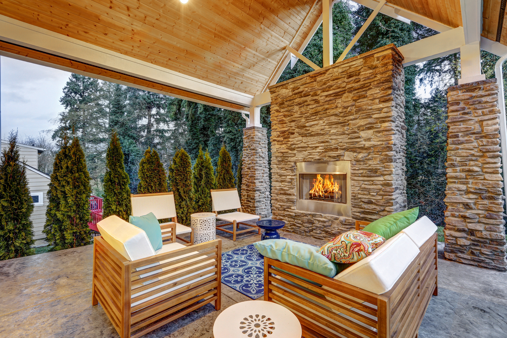 Enchanting patio with a classy outdoor living set near the stylish fireplace.
