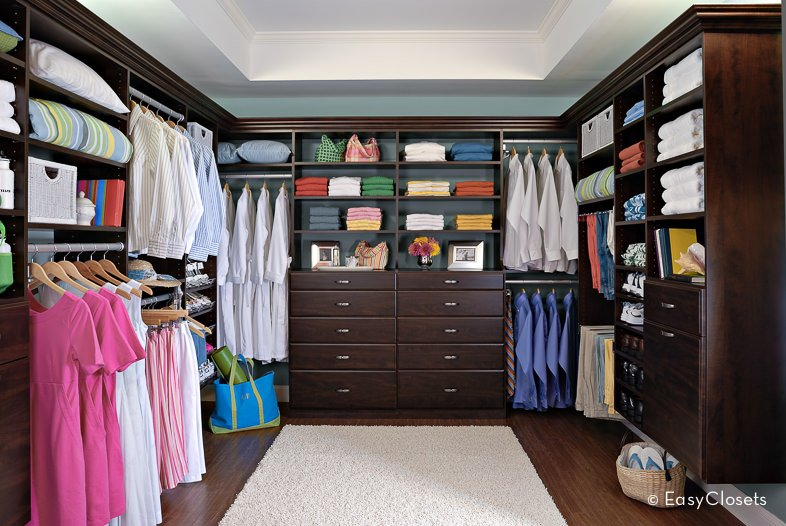 Several rods allow you to hang all your clothes and keep them wrinkle free while a chest of drawers provide space for keeping more personalized items out of sight.
