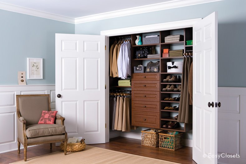The air of elegance and chicness makes this the perfect closet for the modern woman. The closet has silver-colored trims with graceful sliding doors. The inside is carved with dark wood that nicely balances the cool tones of the white door and walls. The closet perfectly complements the living room with its warm and cool shades.