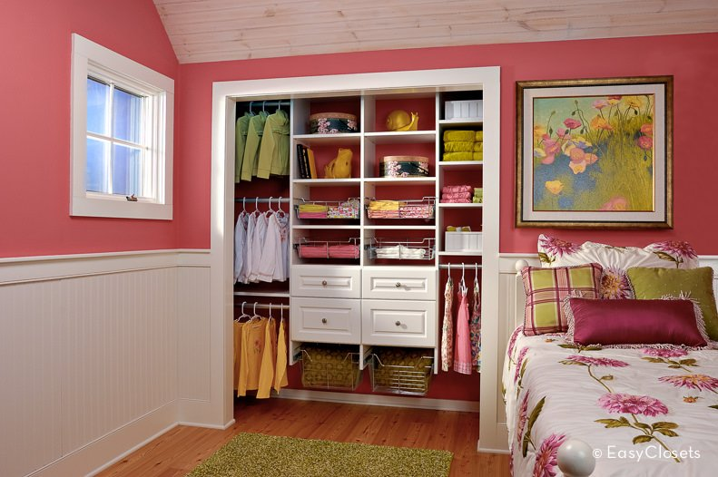 Small girl's bedroom closet featuring a white cabinetry.