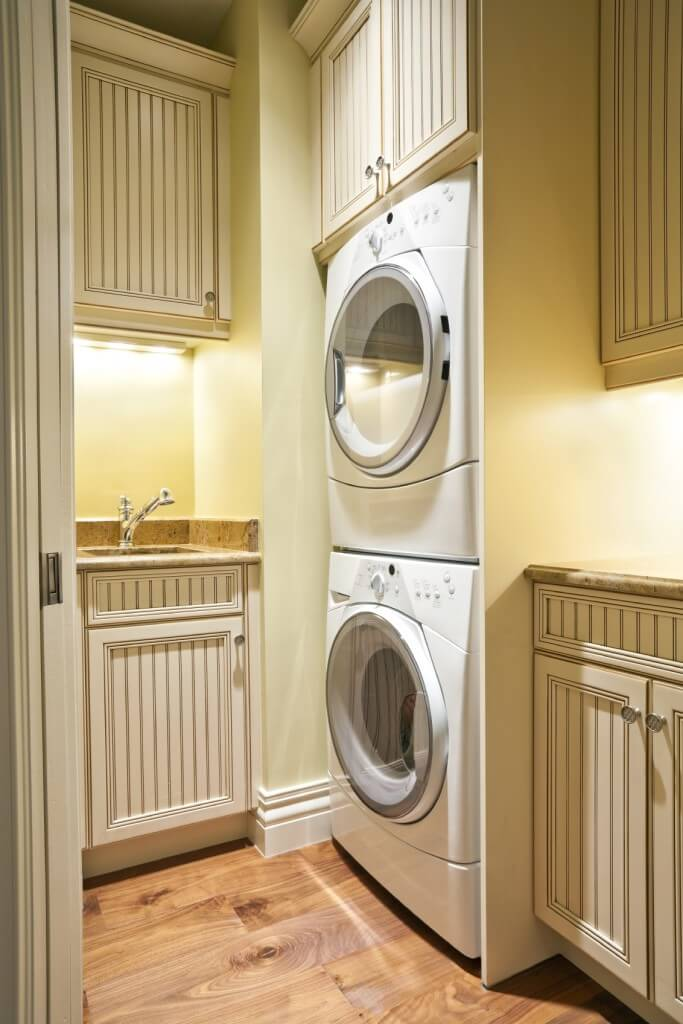 20 laundry rooms with stackable washer and dryer photo ideas home stratosphere - Washer dryers for small spaces ideas ...