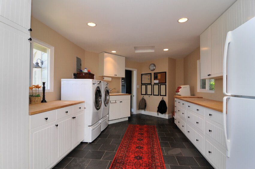 Large laundry room design with loads of storage.
