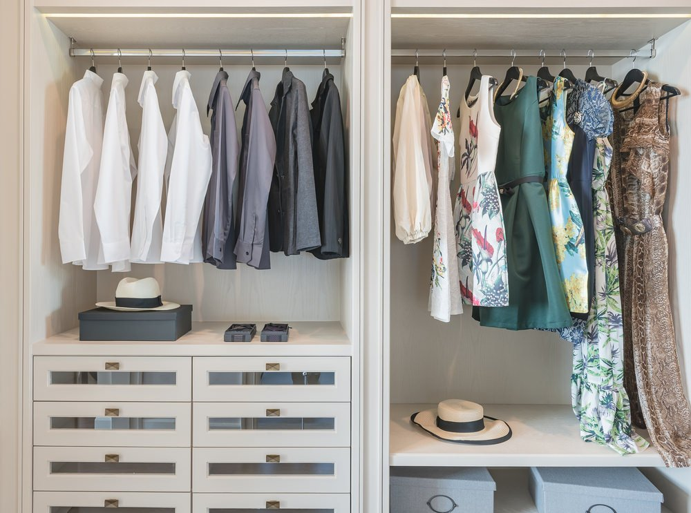 Close up look at this lovely women's modern closet with a classy finished cabinetry.