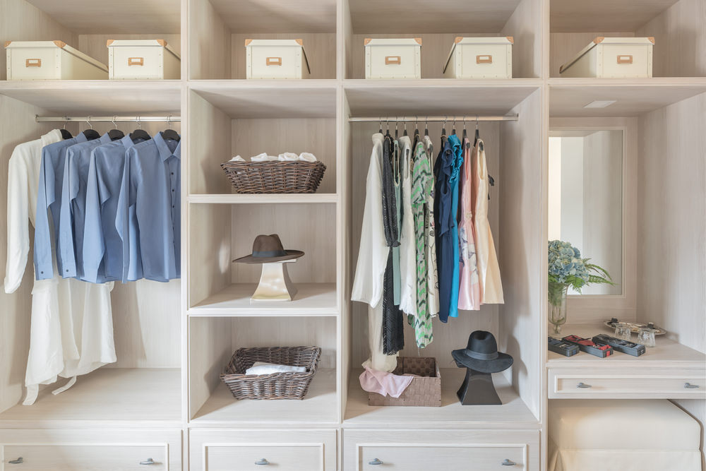 This women's modern closet features a lovely cabinetry and shelves.