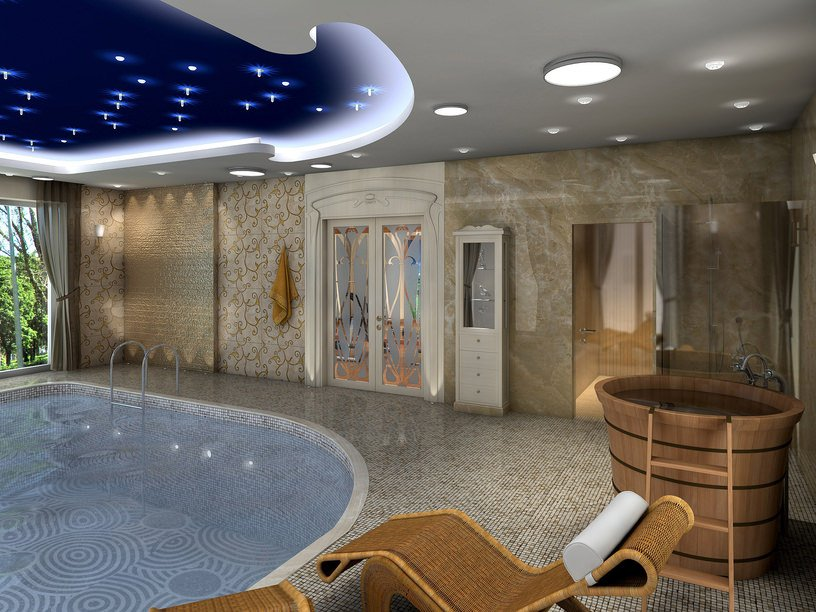A stylish french door opens to this indoor pool with a swirl design. It is illuminated by recessed lighting fixed to the fabulous tray ceiling and accompanied by a wooden hot tub and loungers.