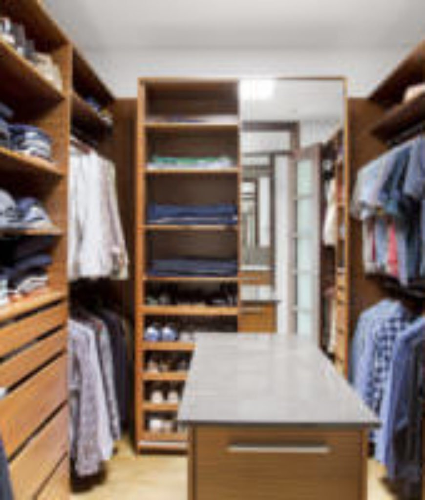 Walk-in Closet with wood paneling.