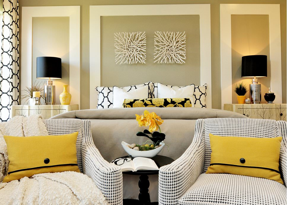 Yellow and beige master bedroom with wicker furniture.