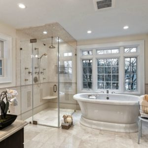 Traditional bathroom design with freestanding tub and walk-in shower.