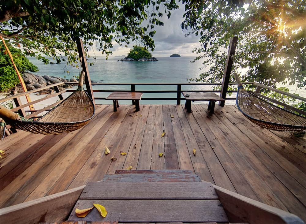 This deck is a stunner. Couple of swings and coffee tables while overlooking the paradise. It's just so amazing and jaw-dropping.