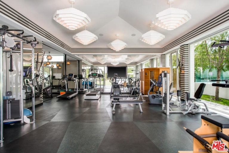 Huge home gyms can be really fun if you are serious about your workouts. Surrounded by windows and greenery can do wonders for your motivation. The portable sauna is also a great addition for the gym since it helps you relax post-exercise.