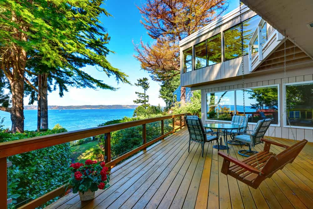 Magnificent deck with a coffee table sets, a small swing and beautiful greenery surrounding the place. The deck overlooks the beautiful ocean.