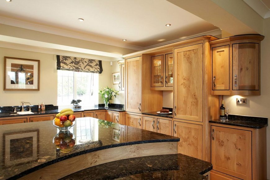 This kitchen offers granite countertops on both kitchen counters and center island. The lighting looks perfect together with the tray ceiling.