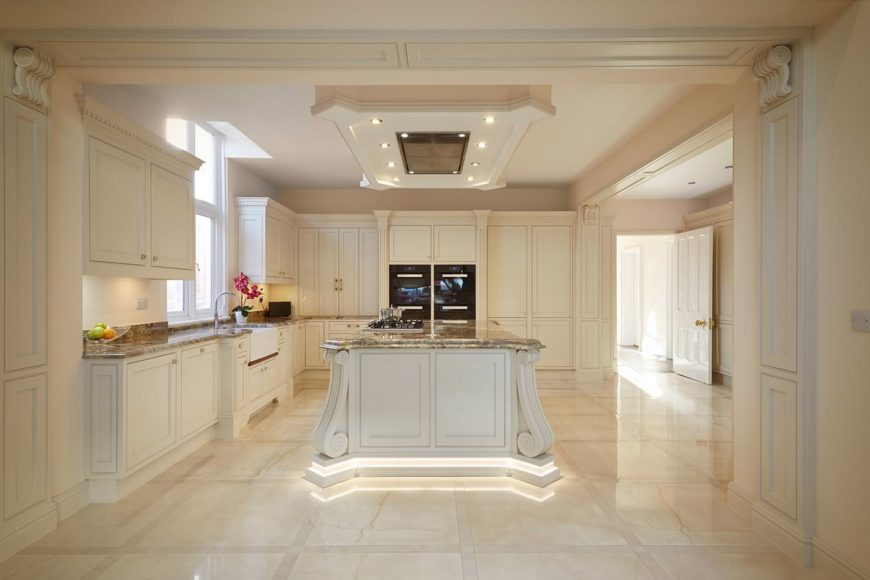 A beautiful kitchen setup with attractive floors and ceiling. It also offers a classy center island and kitchen counters.