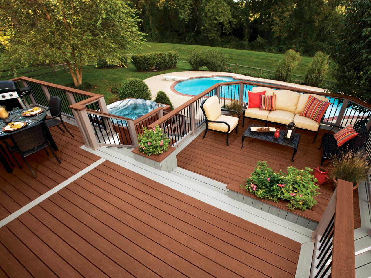 This modish deck features a small dining set, a sofa set with a center table, and some plants for additional colors.