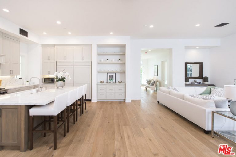 Open concept kitchen and family room in Jane Fonda's home.