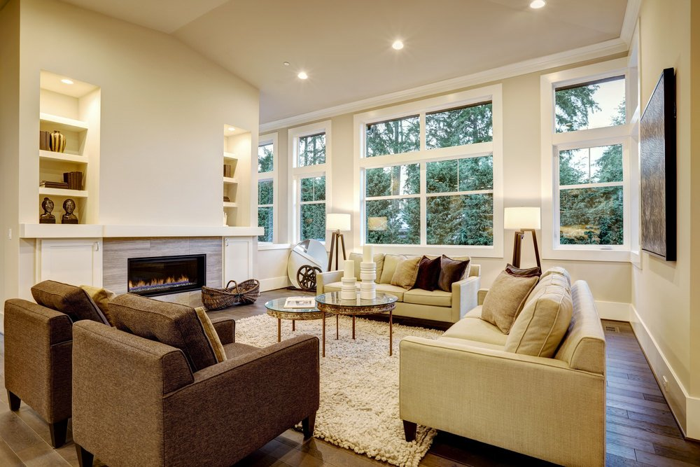 This traditional living room boasting lovely seats and lighting also offers a fireplace. The hardwood flooring looks perfect together with the room's style.
