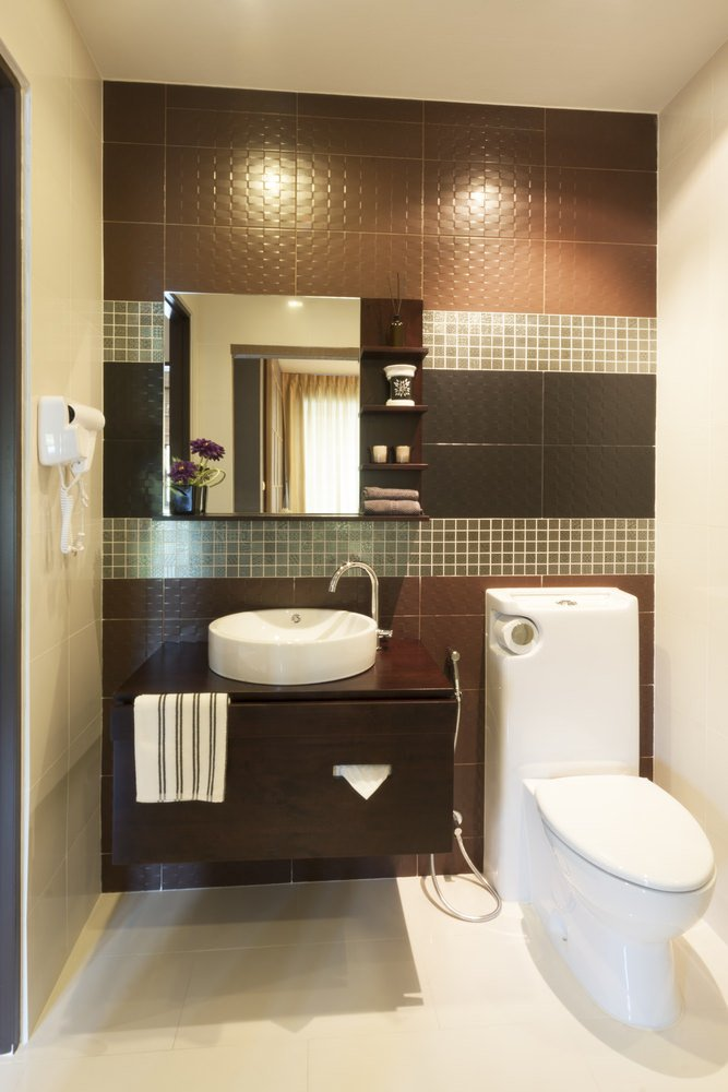 Contemporary powder room with purple, brown and white color scheme.