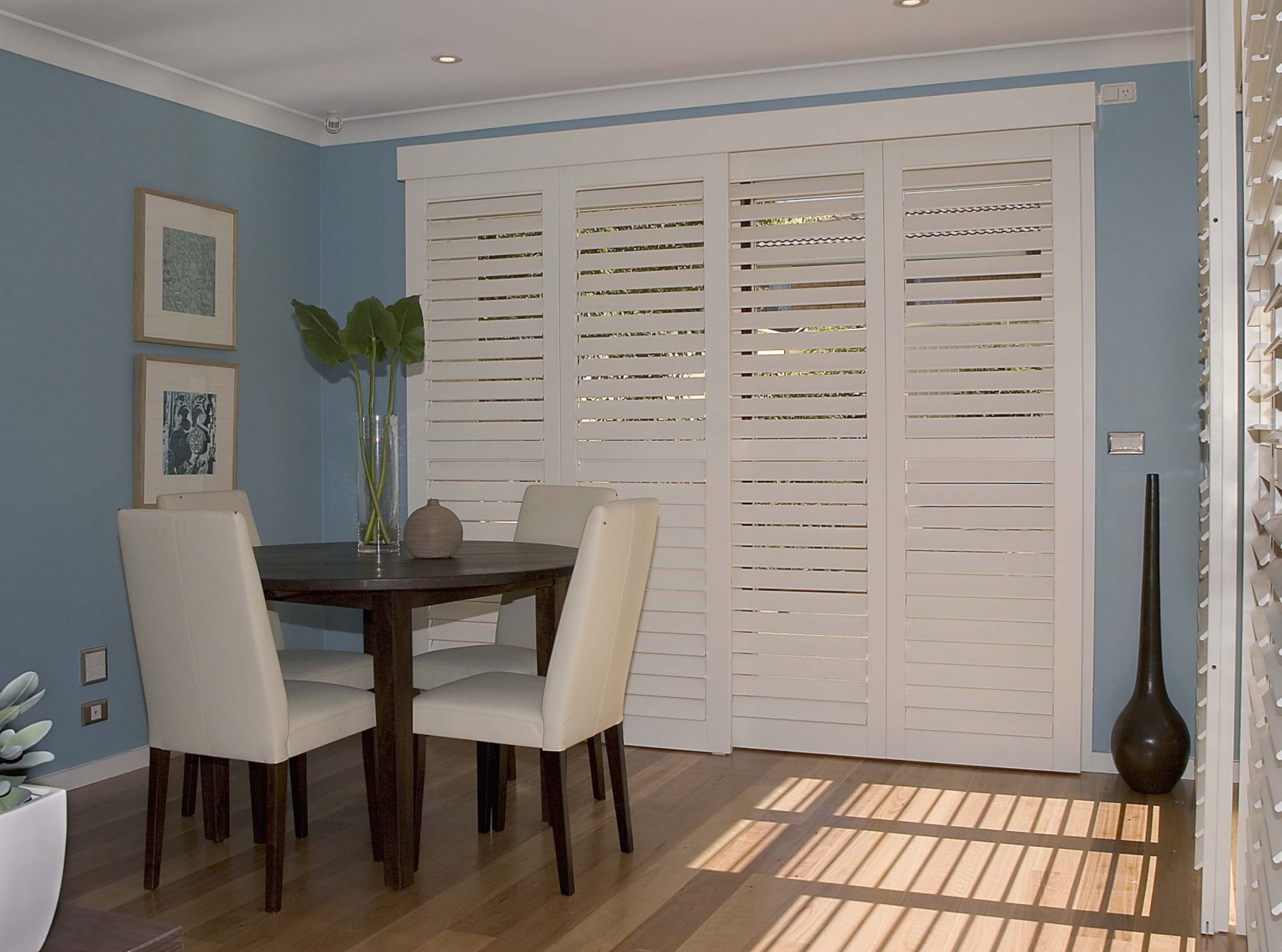 Shutters for dividing a room