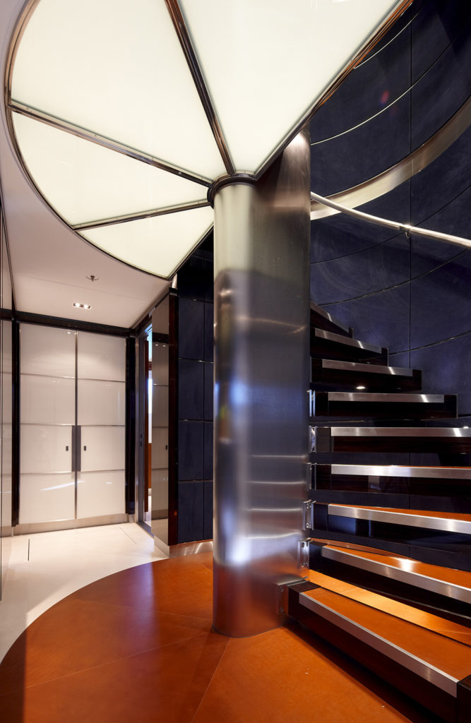 A modern home featuring a stunning spiral staircase with an orange shade.