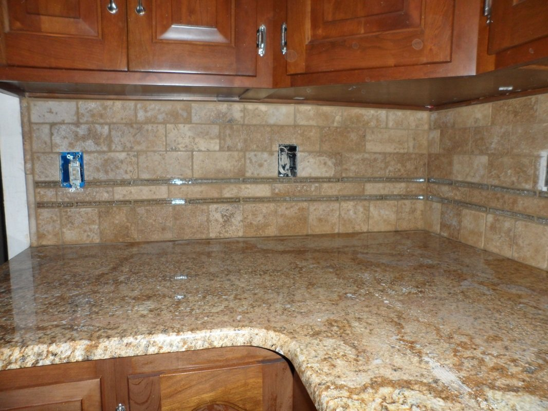 Stone tile kitchen backsplash.