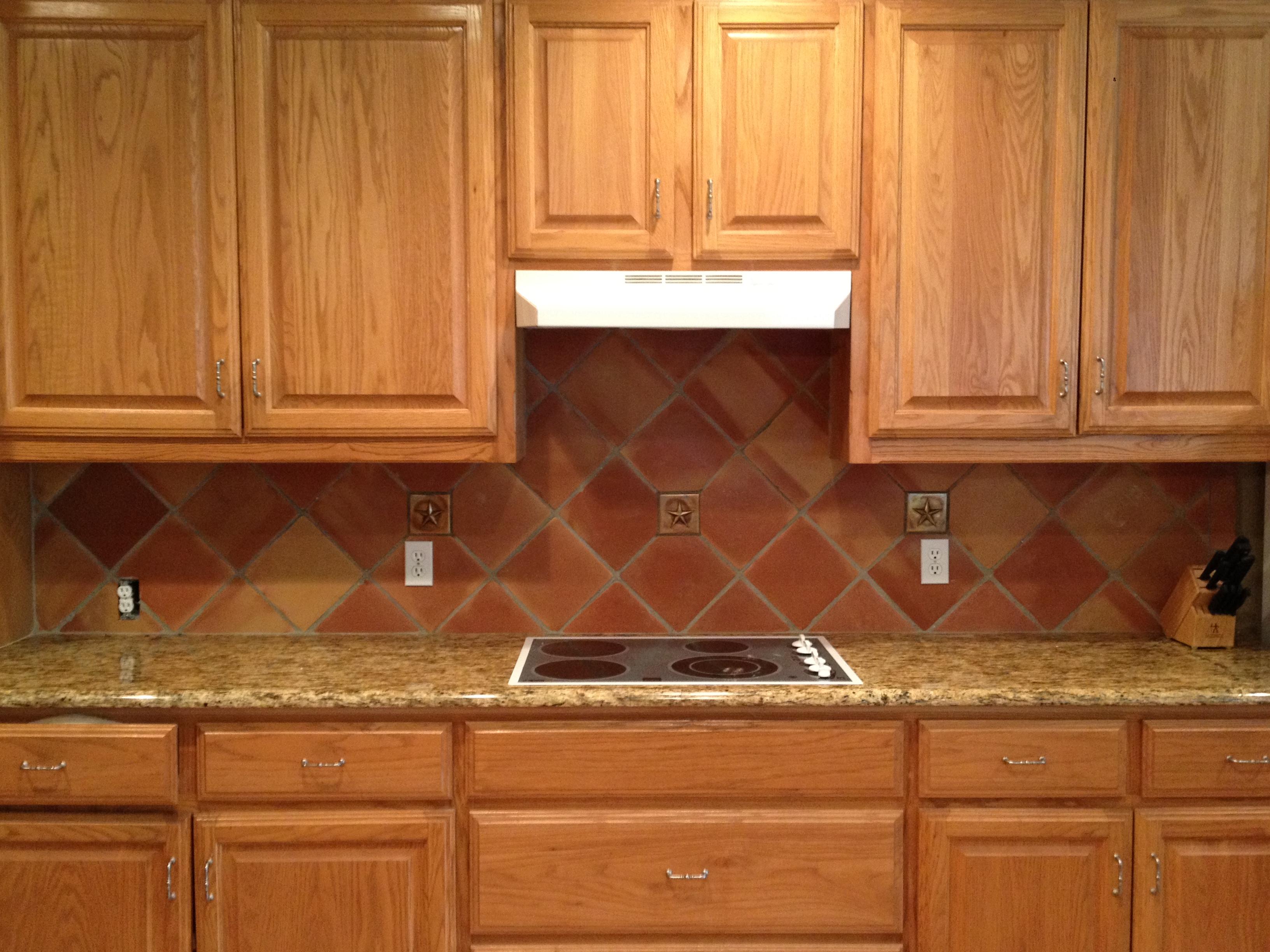 Terra-cotta kitchen backsplash.