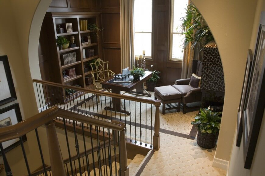 Second floor landing featuring a carpet flooring. The staircase leads to the small home office.