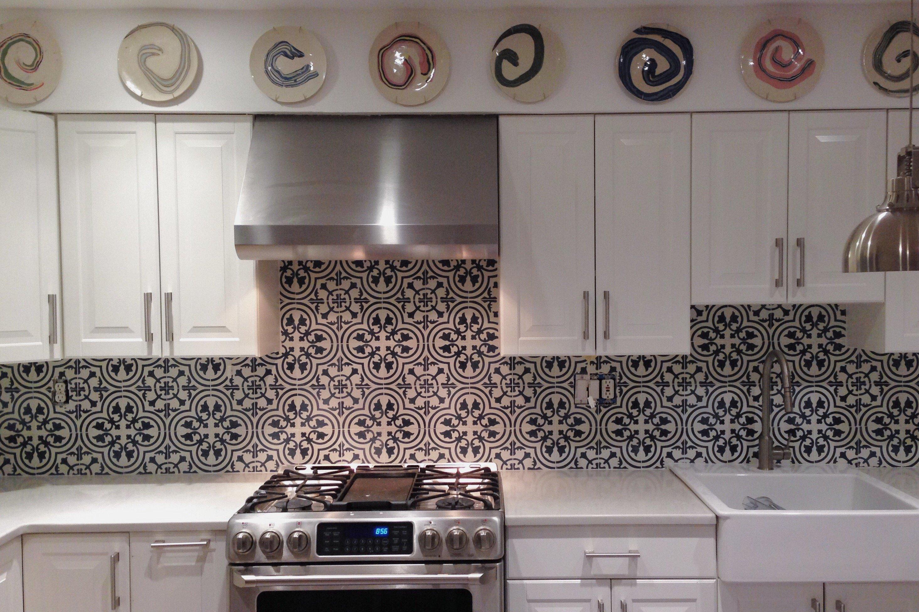 Cement tile kitchen backsplash.