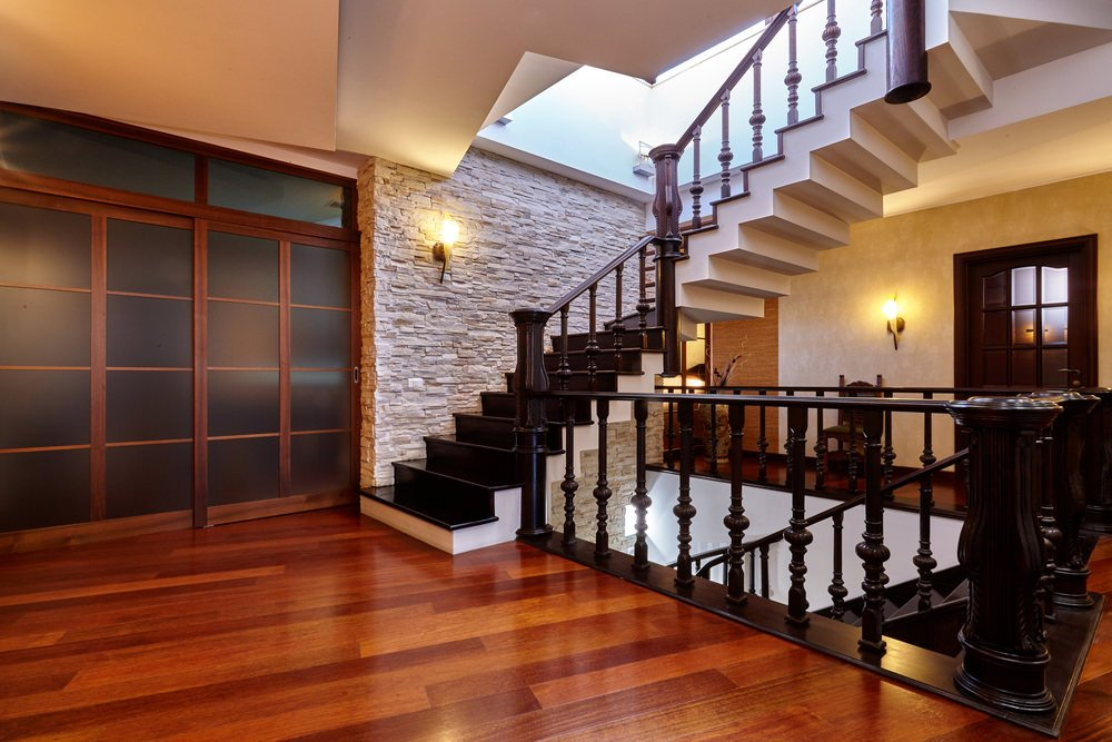 This second floor landing looks gorgeous with its flooring and staircase lighted by classy wall lighting.