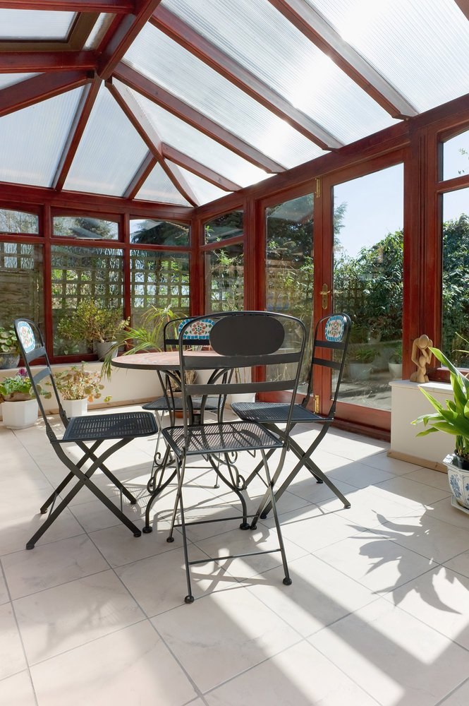 A contemporary type of sunroom located near the garden for that fresh environment.