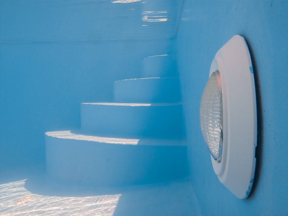Surface mounted swimming pool light.