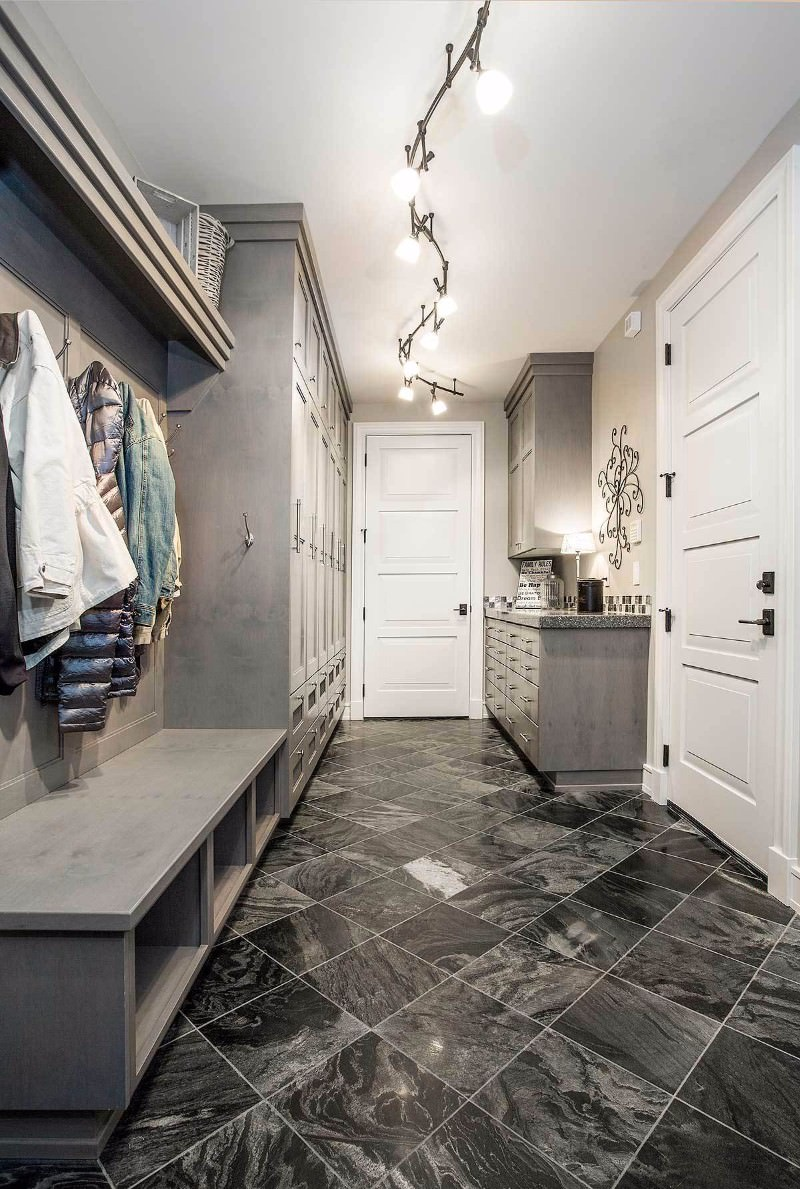 Modern-style mudroom with tiled flooring.
