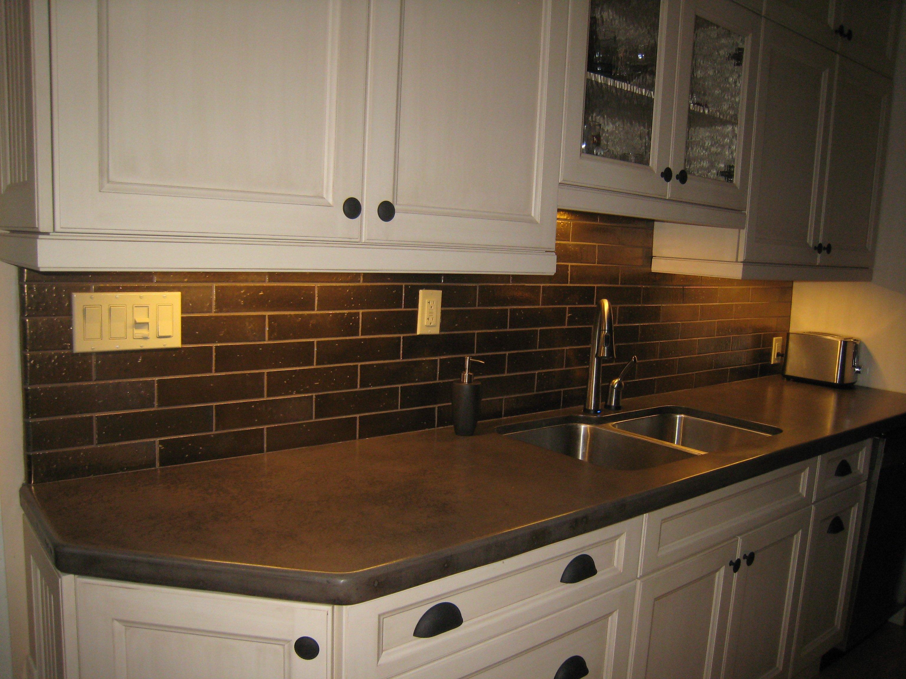 Brown kitchen backsplash.