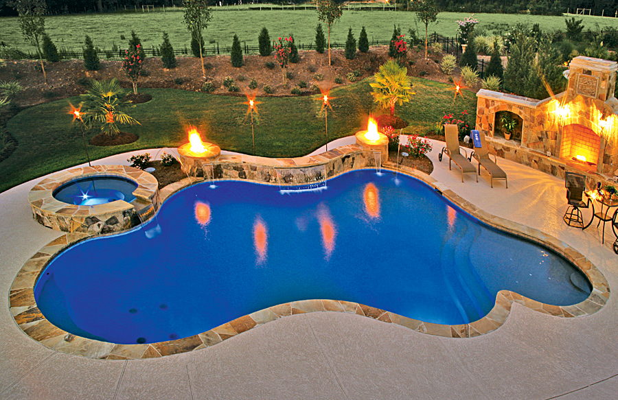 A custom swimming pool lighted by glamorous lights.
