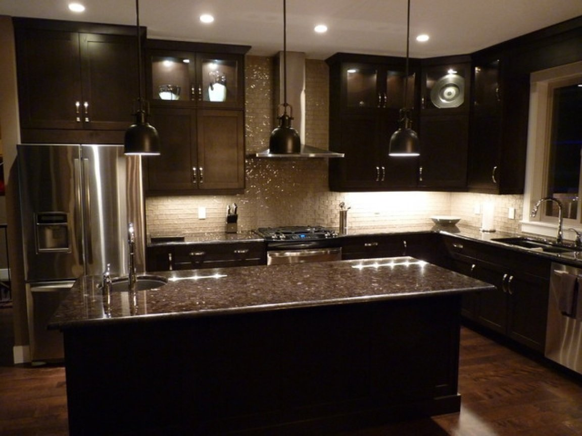 Dark wood kitchen cabinet image