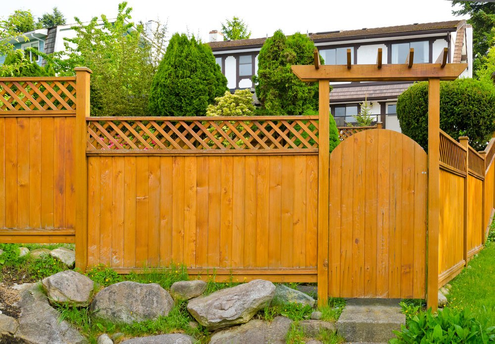 Wood arched fence gate.