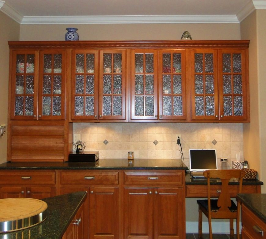 Glass front kitchen cabinet image