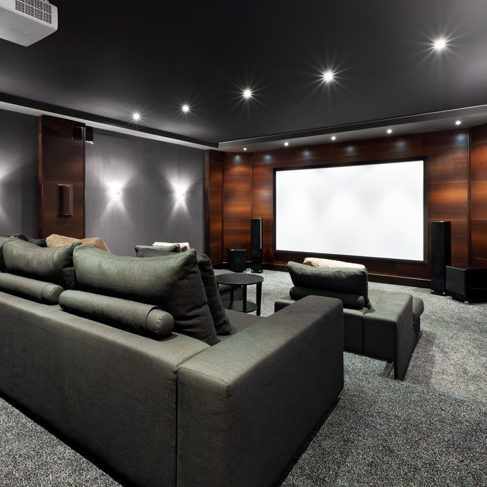 Contemporary home theater featuring stylish walls and stunning elegant black ceiling.