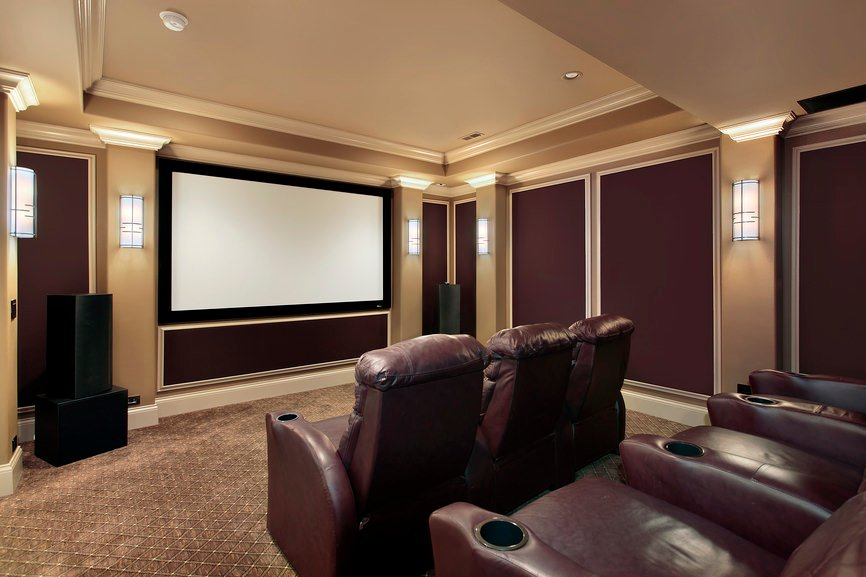 Simple home theater featuring fancy walls and classy tray ceiling together with the stylish wall lights.