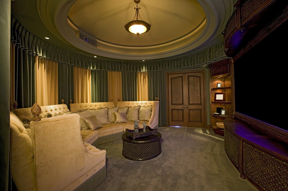 The circular sofa set in this home theater offers a cozy and comfortable movie watch together with family and friends.