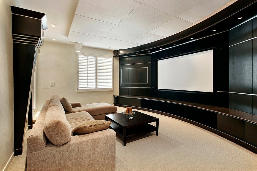 This home theater features black and white shade for additional elegance and beige carpet flooring making the room look more classy.