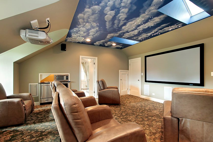 This home theater boasts elegant carpet flooring and a very stunning ceiling along with brown leather sectional theater seats.