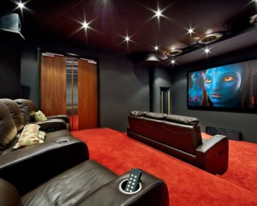 The recessed lights, leather couches, widescreen LCD and carpeted floor make this media room an elegant-looking mini cinema.