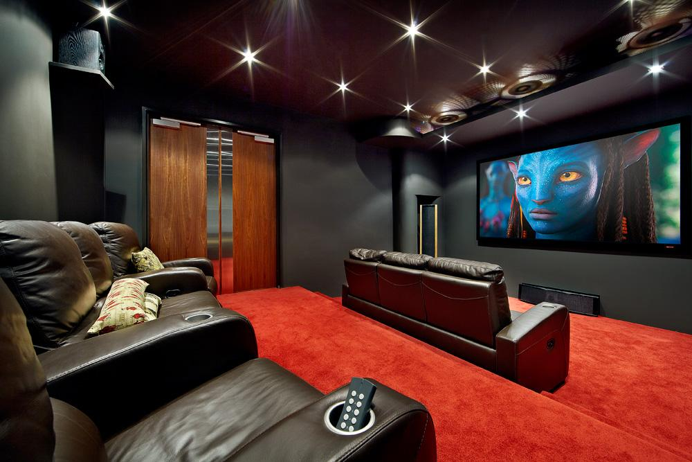 The Recessed Lights Leather Couches Widescreen Lcd And Carpeted Floor Make This Media Room