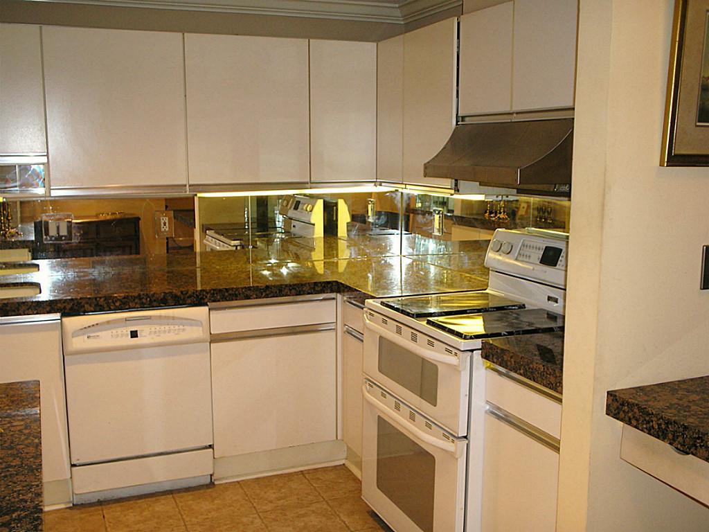 Mirror surface kitchen backsplash.