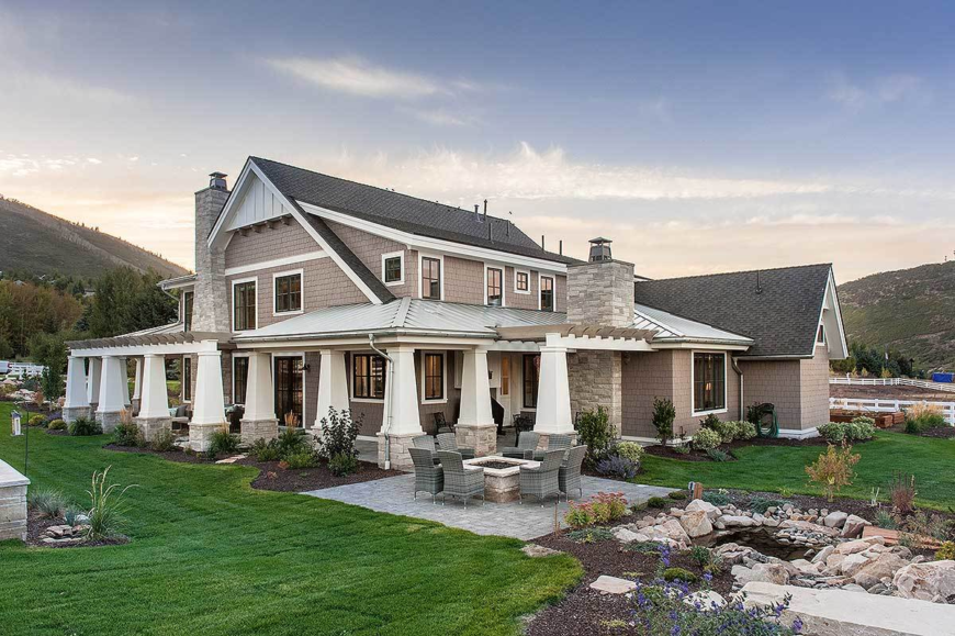 This lovely home features a beautiful garden area and a patio with a fire pit.