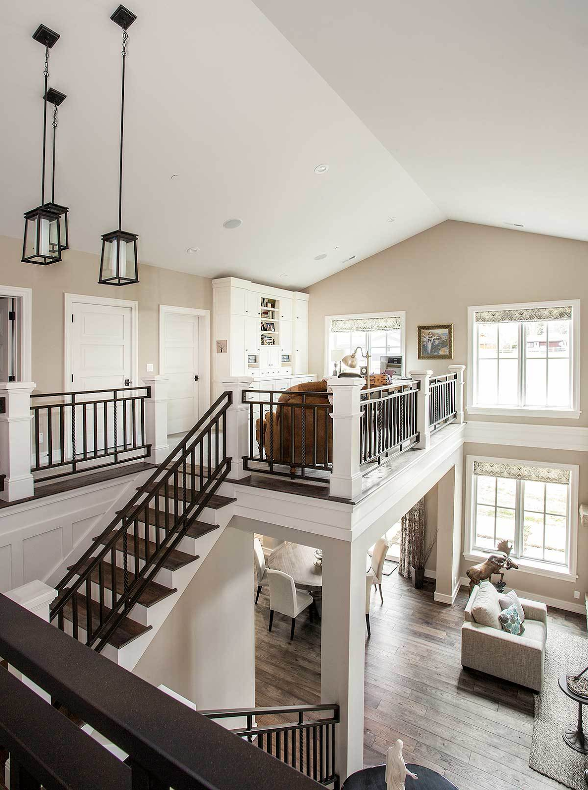 This elegant home features a stylish staircase leading to the home's second floor landing where the home office is located.