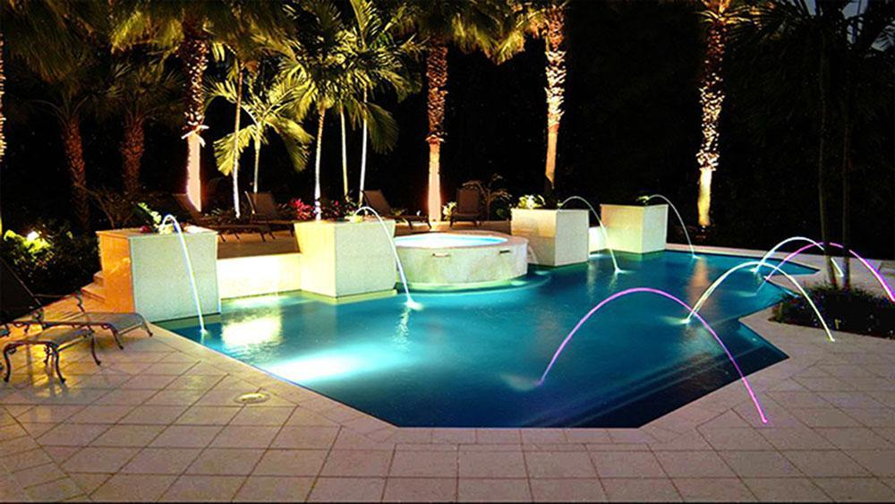 Laminar jets shooting water into a pool at night