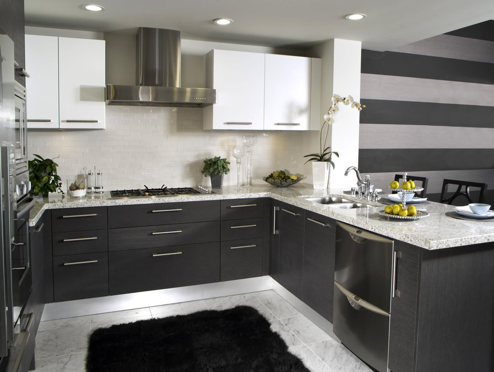 Stylish kitchen with espresso finished counters equipped with marble countertops.